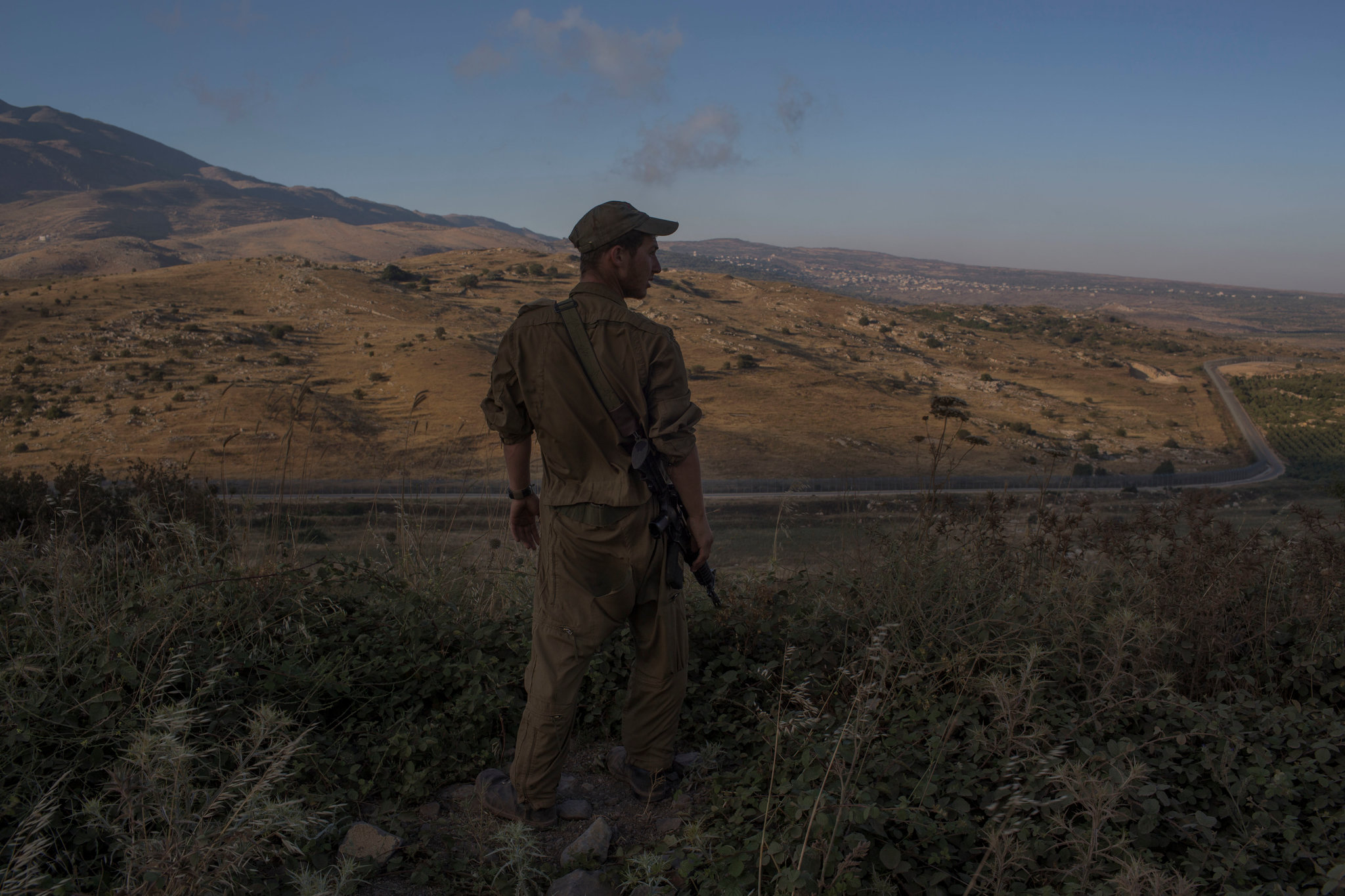 Israeli soldier overlooking Golan Heights