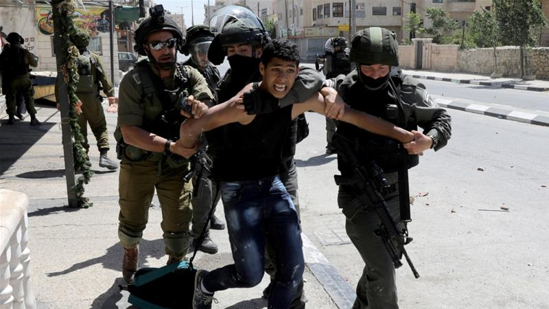 Palestinian child being arrested